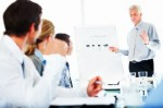 istockphoto_8940493-businessman-giving-a-presentation-in-front-of-her-colleagues