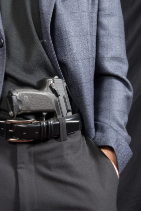 Threatening gesture - Revealing a handgun
