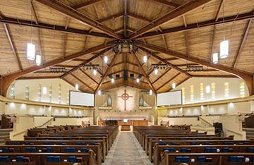 Faith Presbyterian Church in Cape Coral, FL,recently expanded its sanctuary and updated its audio system. The church also expanded its stage lighting and added projection.  (Photo courtesy of Custom Sound Designs)