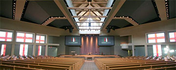 Here's a photo you can use, too, plus a caption: Our Savior's Church (Lafayette, LA) — To accommodate its rapidly growing congregation, the church sought a new 1,100-seat expandable worship center to serve as the permanent campus in Lafayette. The new facility needed to have a high level of audio, video and lighting systems to support the dynamic praise and worship. Idibri worked with the church and design team to incorporate the acoustical recommendations and technical systems into the architecture. This involved special attention to the unique architectural features, particularly the ceiling which included a center pop-up with windows and an eye-brow over the platform. Accommodations were provided for future expansion into a dedicated video production room when they decide to include camera systems for Image Magnification or broadcast to a satellite venue. (Photo courtesy of Idibri.com)
