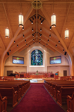 The altar of Atascocita United Methodist Church in Atascocita, TX, is the focal point of the entire room. The surrounding architecture of the space leads the eye directly to the communion table and altar.