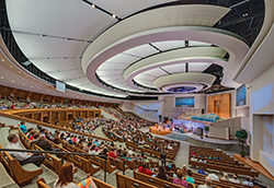 First Baptist Church Pasadena (Pasadena, TX) is quite large, with a 2,800-seat sanctuary. The design challenge here was to accommodate the large congregation while maintaining a sense of intimacy. This was done through the use of tiered and gather-round seating. Photo shown is taken from the furthest point of the sanctuary.