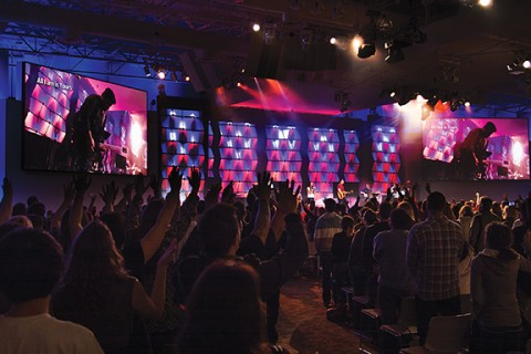 Band leading worship, hands raised everywhere in the formerly Fuel crowd.