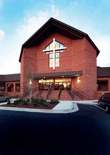 At Beacon Baptist Church in Raleigh, NC, a cost-efficient metal building clad with brick offers a dramatic visual exterior. The striking and attractive entry helps build the church's image as a progressive and dynamic community. Inside, its column-free structure allows excellent site lines and abundant sanctuary seating.