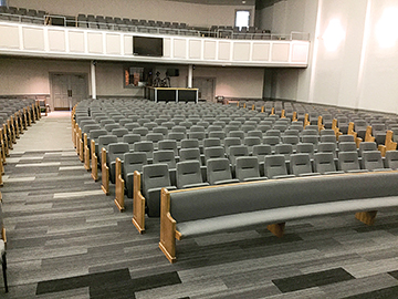 Sauder Worship Seating installation at Apex Baptist Church (Apex, NC) — a combination of radial and mitered pews, along with Clarity auditorium seating