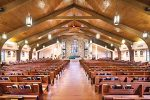 Sauder Worship Seating installation of straight and Radiance curved pews in Saint Francis of Assisi in Triangle, VA