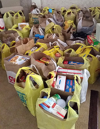The results of a grocery drive at Faith Reformed Church were bolstered with the use of notification technology.