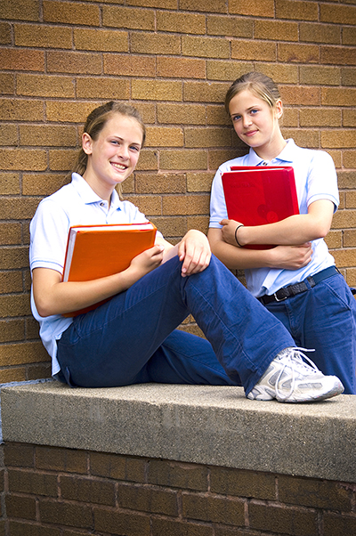 Two girls in school uniforms